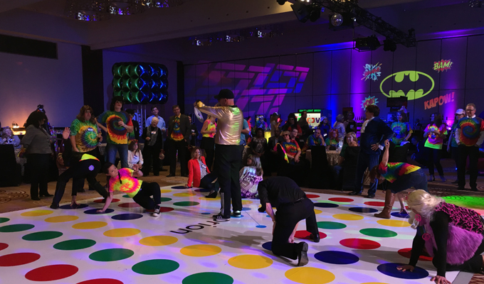 Decades-Decor-Under30-Attendees-playing-twister