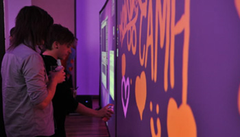 A virtual graffiti wall, sponsored by Virgin Mobile, was a hit among guests at UnMasked 2011, a CAMH fundraiser