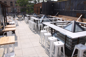 Gusto 101's skylights make unique bar tops on its rooftop patio