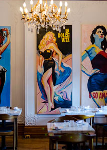 Playful touches such as retro paintings preside over Osteria dei Ganzi's historic interior
